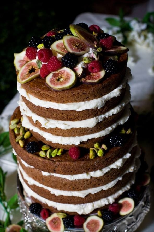 This wedding cake is topped with fall fruit. Figs and blackberries make for pretty dessert for the reception.