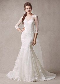 Elegant and sophisticated, you will look fierce in this luxurious wedding gown! Trumpet chantilly lace gown with stretch tulle yoke and sleeves with embroidered lace appliques. Point d'esprit sweep train. Sizes 0-14. Available in Ivory in select stores and online. Sizes 16-26 available in store by special order. Petite: Style 7MS251089. Sizes 0P-14P. Available for special order in all stores. Fully lined. Center back zip. Imported polyester. Dry clean only. To preserve your wedding dreams…