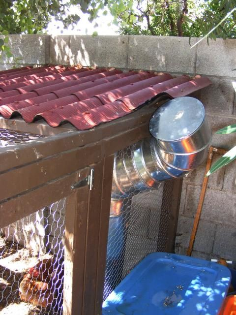 Metal Air Duct and a Flower Pot CHICKEN FEEDER!! GREAT Idea and it holds 75lbs resistant to critters, easy access and stays clean! This SITE HAS TONS of ideas for FEEDERS AND WATERERS!! check it out!