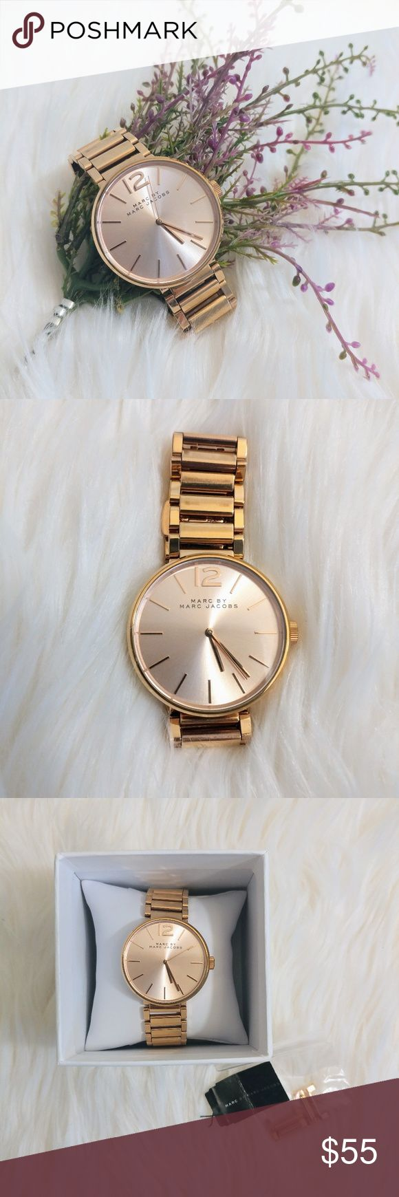 Marc by Marc Jacobs Rose Gold Watch Brand: Marc by Marc Jacobs Peggy Rose Gold-Tone Sunray Dial Ladies Watch Case diameter: 36 mm. Water resistant at 50 meters / 165 feet.?  Normal wear, comes with the box and the extra stainless bracelet pieces. Marc by Marc Jacobs Accessories Watches