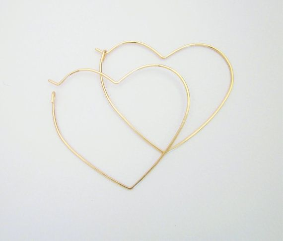 Hand formed hoop earrings in hearts and a litte hammered for texture. 12k gold filled wire 18gauge (~1mm thickness) or sterling silver wire  You will receive a new pair not the ones modeled.  - hearts appr. 45mm  - comes in a pretty little packing. If this is a gift - let us know please   . . . . . . . . . . . . . . . . . . . .  T R A C K I N G for US, Canada, UK buyers - two option: FULL TRACKING up to the moment Delivered - please choose the 2nd shipping option for $7.50 when checkout…