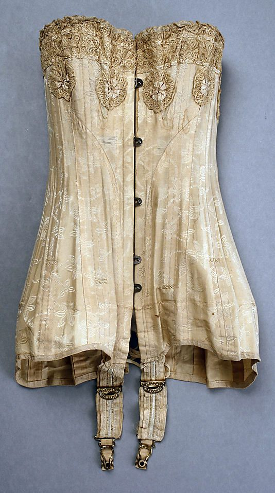 """Corset, 1909, American. By the turn of the century, corsets became longer as the """"S"""" shape accentuated the bust and the hips."""