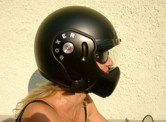 black roof boxer helmet on female