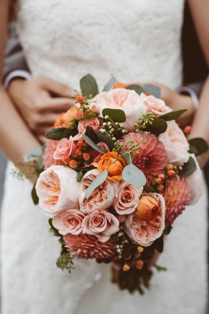Peach dahlias, Juliet garden roses, orange ranunculus, peach hypericum berries, and seeded eucalyptus bridal bouquet for a lovely DIY autumn wedding  Photography: Avangard Photography - avangardphoto.com  Read More: http://www.stylemepretty.com/canada-weddings/ontario/2013/10/14/diy-wedding-at-pheasant-run-golf-club-from-avangard-photography/