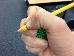 For kids who can't help but have an awkward grip on their writing utensils, have them hold a cotton ball or small rubber ball between ring and pinky fingers. | 37 Insanely Smart School Teacher Hacks