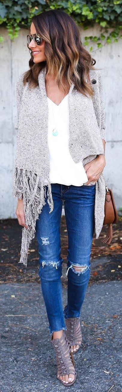 #winter #fashion /  Beige Fringe Poncho + White Top + Ripped Skinny Jeans