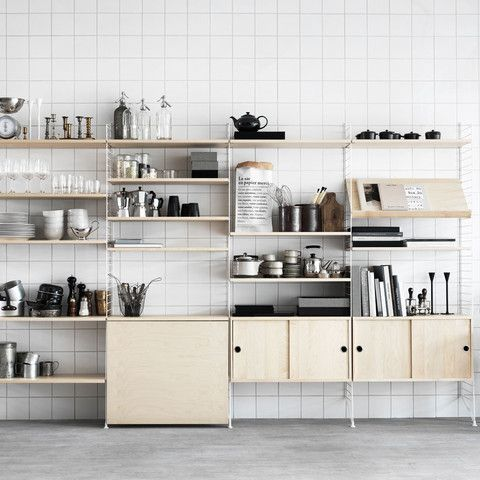 STRING SHELVING SYSTEM BY NILS STRINNING  'Modern since 1949'. String is the original component shelving system designed by the Swedish architect Nils Strinning in 1949. He was one of the leading mid-twentieth century designers who built the foundation of what we now call 'Scandinavian design'.
