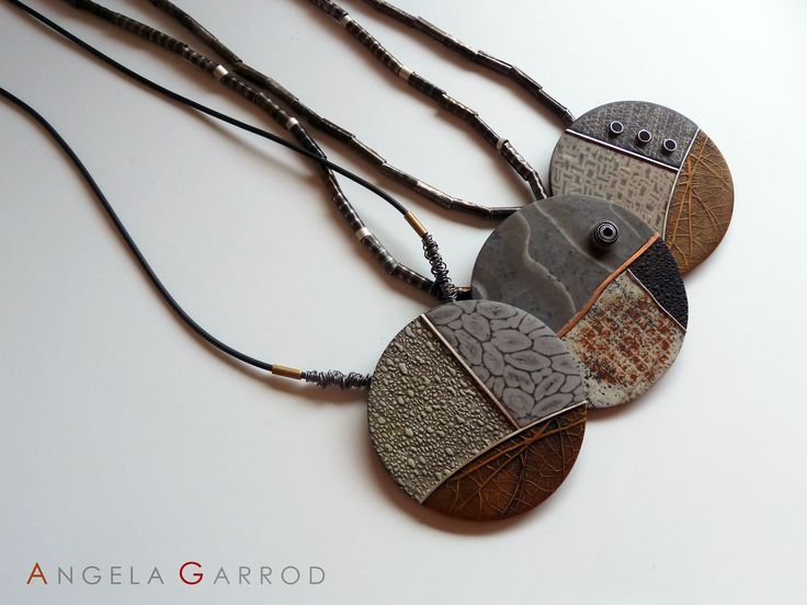 Trio of Necklaces...............................Polymer Clay, Sterling Silver, Aluminium, Brass, Copper and patinated Steel textured and rolled through rolling mill.