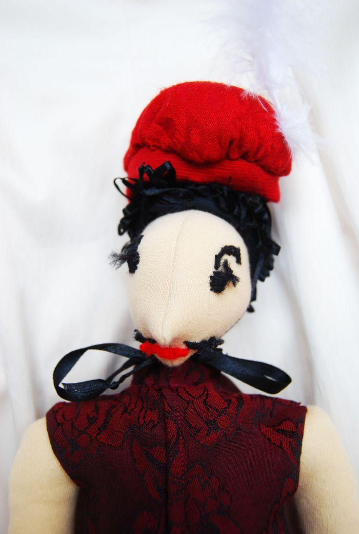vörös Rongylord barett sapkában, portré