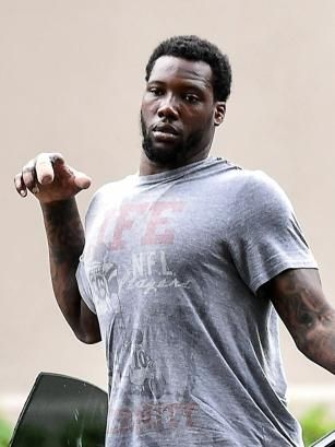 Beleaguered former football star Jason Pierre-Paul reveals the extent of the damage done to his injured right hand as he leaves his training sessions on September 16th and 17th, 2015. The 26 year old looked miserable as he continues the long road to recovery in order to win his job and his $15M salary back despite missing a portion of his thumb in addition to the right index finger he had amputated after his July 4 fireworks accident.