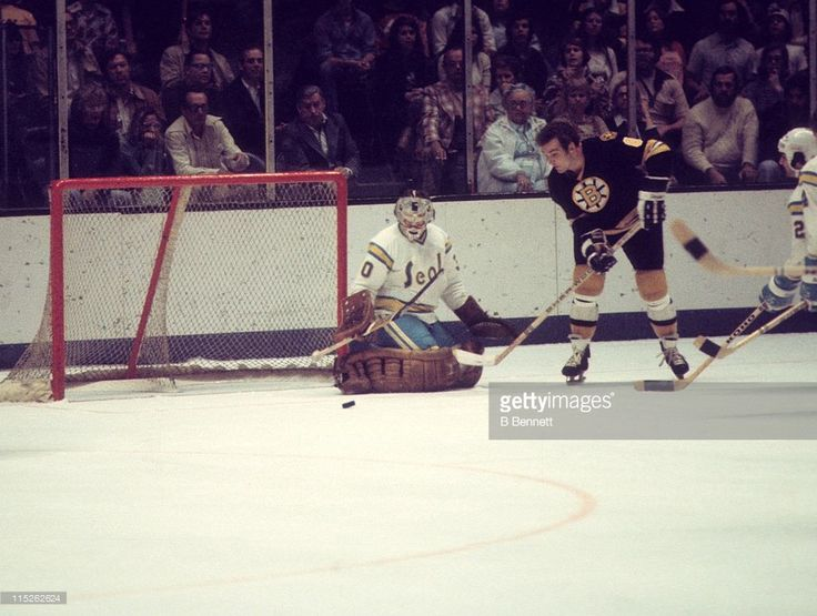 ken-hodge-of-the-boston-bruins-tries-to-score-as-goalie-gary-simmons-picture-id115262624 (1024×773)