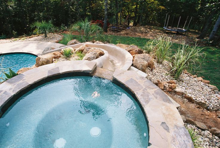 A Spillover Spa A Custom Built Slide And An Inground Pool Amazing Www Brownspools Com