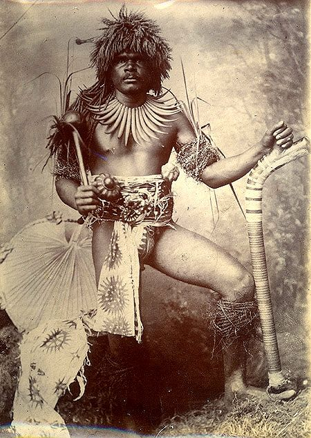 Ethnographic Arms & Armour - Period Photos of People with Ethnographic ArmsFIJI PICTURES SEVERAL FORMS OF CLUBS AND TRIBAL ATTIRE REPRESENTED. AS IS USUAL DURING THAT TIME MOST ALL POSED PICTURES PICTURE WITH SEVERAL BOYS WITH CLUBS TAKEN 1881 IN VITI LEVU HIGHLANDS. WARRIORS DRAGGING DINNER HOME 1940 JUST A REINACTMENT. TWO UNDATED AND THE OTHER ONES 1901 AND 1928.