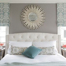 Love the tranquility of this bedroom. Beautiful decor...the starburst mirror mounted over the bed makes a real design statement!   www.franksglass.com