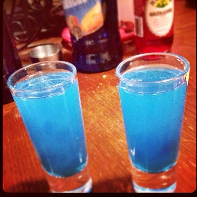 BLUE BALLS SHOT ~ 1/2oz Malibu Coconut Rum, 1/2oz Blue Curacao, 1/2oz Peach Schnapps, 1/4oz Sweet & Sour, Slash of Sprite/7up
