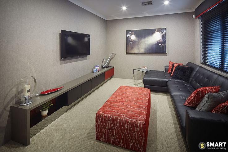 The cosy home of The Apex, with red accents warming the room.