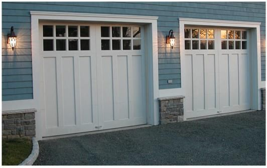 carriage style garage doors. Different exterior color but exactly how I want garage doors to look on he house