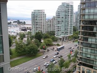 Gorgeous mountain and water views from an apartment suite in Downtown Vancouver #Vancouver #DowntownVancouver #CityGetaways