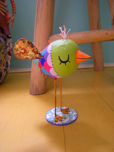 paper mache bird.....(paper mache? this little bird would be so adorable in fabric,too! long wired legs of course. tee.hee.)....