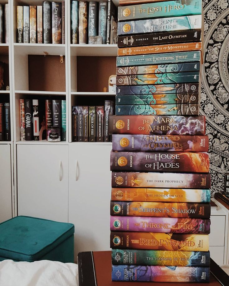 "129 Likes, 8 Comments - Haley • Blogger • Writer • 20 (@mythoughtsareabook) on Instagram: ""》 August 15th - Book Tower ---- 》 All of my Riordan books in one place. This toppled twice and…"""