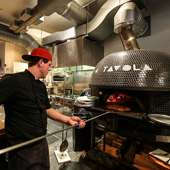 "A Tavola; Cincinnati - This Neapolitan-inspired restaurant's massive, black Stefano Ferrara-made oven weighs ""about as much as a small school bus,"" according to co-owner Nicolas Wayne. The wood-burning oven can reach a temperature of 1,200 degrees & cook pizzas in just 90 seconds. Must try: Fig + Prosciutto, a sweet-savory pie topped with fig jam, prosciutto, Fontina cheese & arugula salad. atavolapizza.com"
