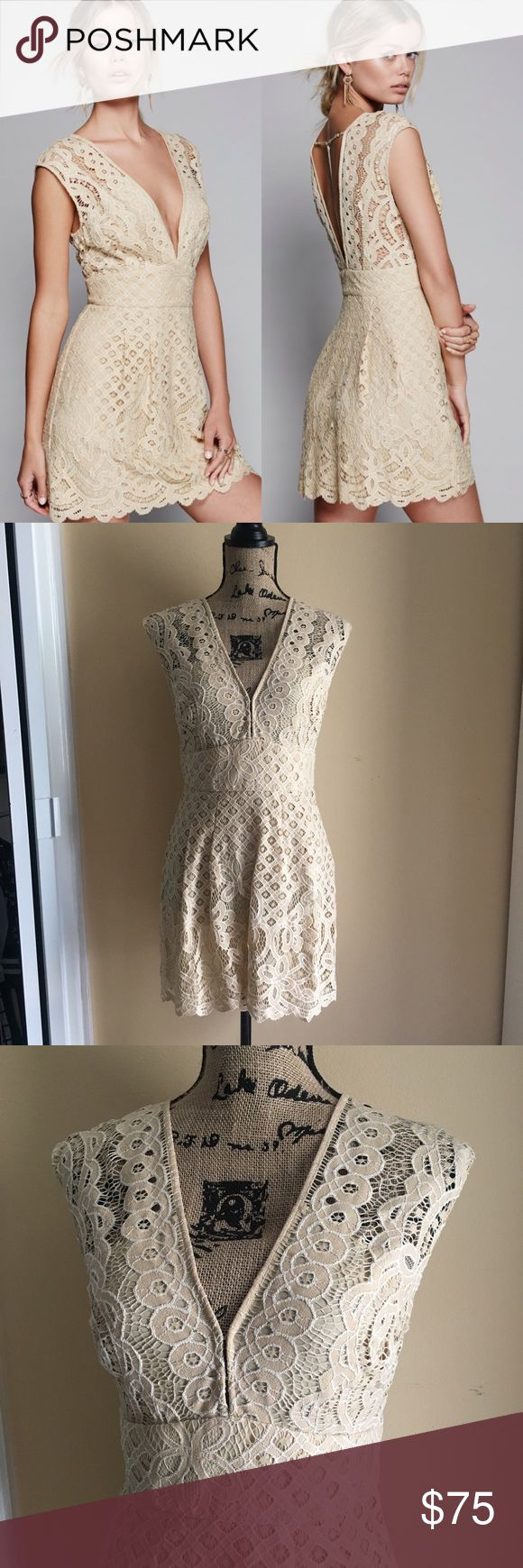 """Free People One Million Love Lace Baby Doll Dress Lovely lacey dress featuring a front and back plunging V with a cute back strappy detail. Femme fit-and-flare shape. Hidden side zipper closure. Lined. Brand new without tags   40% Nylon 60% Cotton Hand Wash Cold Import Measurements for size 4 Bust: 18.5"""" = 46.99 cm Waist: 28"""" = 71.12 cm Length: 33"""" = 83.82 cm Free People Dresses Mini"""