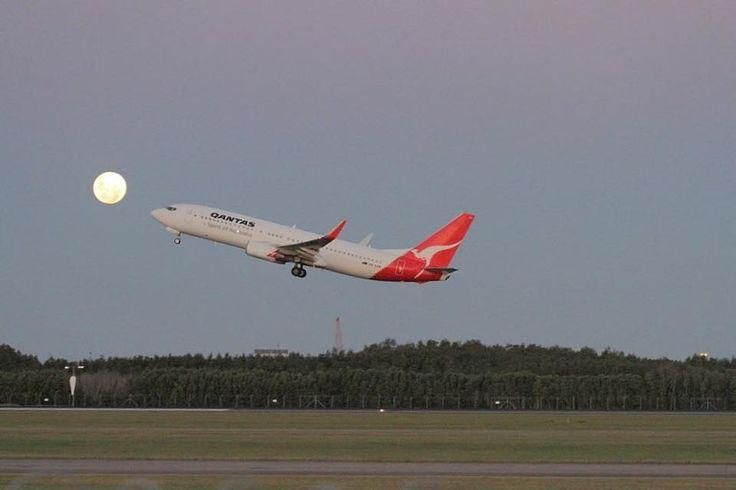 Qantas plane flying out of Brisbane Australia