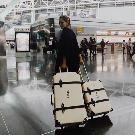 Whether you're flying to a winter wonderland, a beach holiday or somewhere in between, may your journey be as stylish (ahem, monogrammed luggage) and comfy (ahe