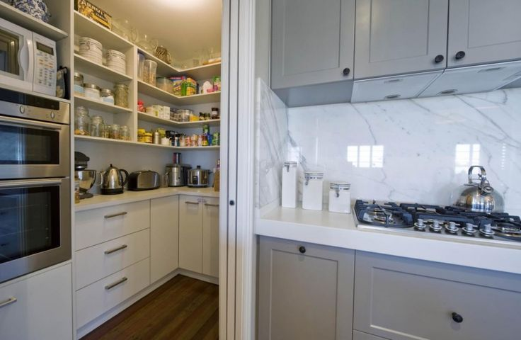 Kitchen with scullery - functional layout, oven and microwave tucked away within easy reach, hotplates in main kitchen
