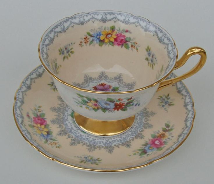 Shelley 'Crochet' pattern. Shelley is the only English potter to put as much imagination into shape as it does to pattern. That is why their pieces, especially the cups and saucers, are loved by collectors and always in demand. This cup and deep saucer are decorated with floral sprays and delicate lace borders and the handle, foot and rims are gilded.