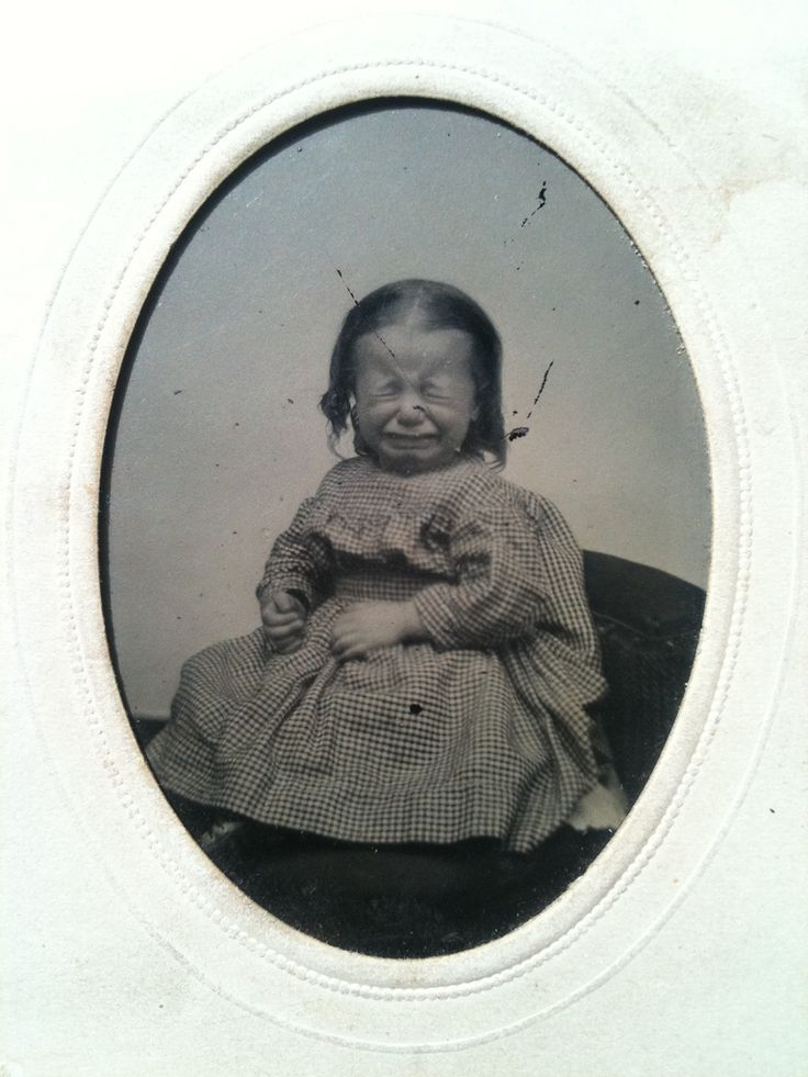 From the collection of 'smokeylace' on flickr. [Some things were never easy, including studio pictures of babies. Poor baby, poor mama, poor photographer!]