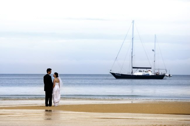 Abel Tasman National Park wedding package including travel into the Park on a yacht, enjoying food and drinks before disembarking onto a golden sand beach for a personal wedding ceremony.