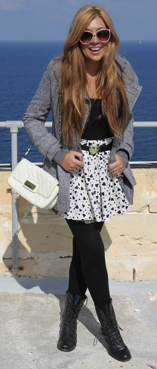 grey jacket over black top w/ white polka dot skirt & black tights.