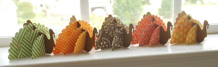 Love this Thanksgiving decoration idea. Cute little paper turkeys. I have so much scrap book paper, I need to find SOMETHING to do with it.