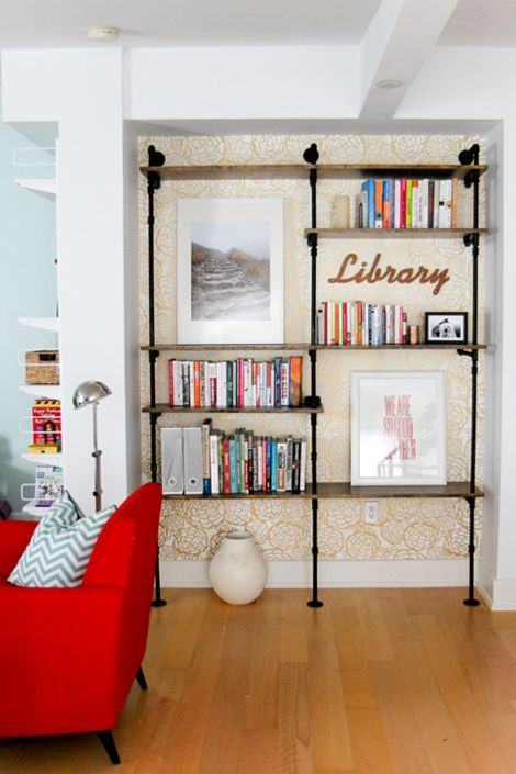 Love this idea of using fun wallpaper and pipe shelves.  From Oh Joy! using her Petal Pusher wallpaper.