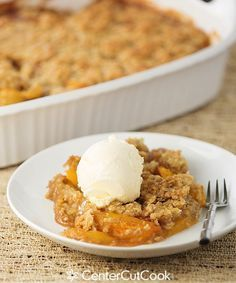 An easy recipe for Peach Crisp topped with an oatmeal, brown sugar, and butter topping. YUM!