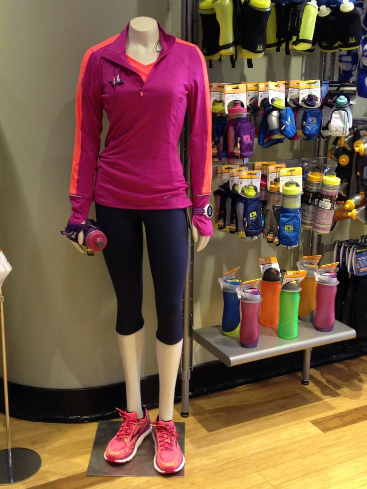 #FFSChgoMannies > Sheila at the South Loop is ready for Spring running. She is wearing the Brooks Essentials 1/4 Zip in Fuschia and the Infiniti Capri with her all-new Brooks Transcend. She never leaves the store without her Yurbuds or Nathan hydration and logs her miles on the snazzy Garmin 220!