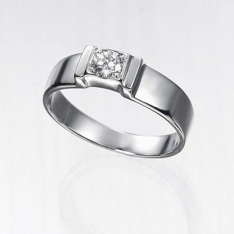 Anillo solitario de diamantes GEA  Anillo solitario con diamante central talla brillante engastado en una montura de oro de 18 kilates de cuatro garras y brazos planos.