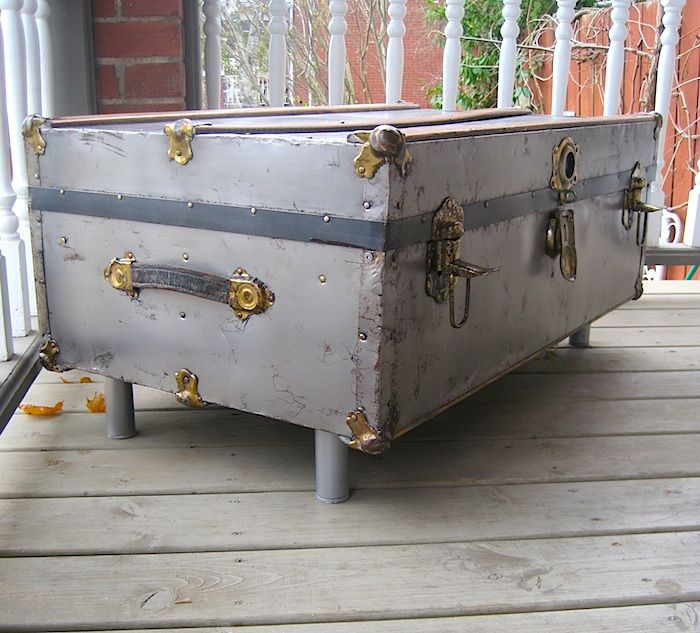 Repurposed vintage metal trunk, stripped and clear-coated with added legs - www.portaverdestudio.com