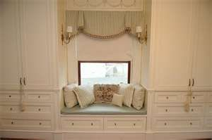 window seat between built-in wardrobe/dresser drawers.  With sconces for reading.  - not quite my style here, but fun concept