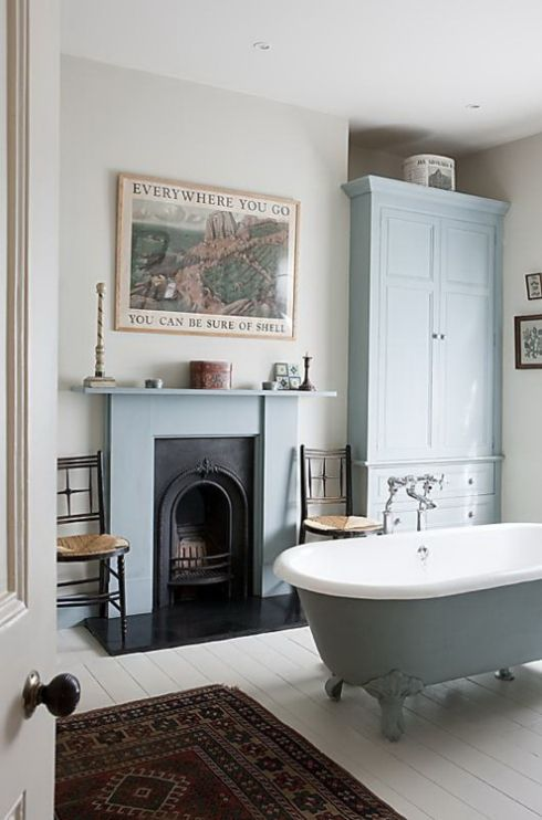 blue and white period bathroom with fireplace