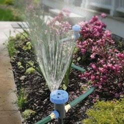 """3 """"In-Line"""" Sprinklers With Timer water almost any configuration of yard at once. 3-in-1 sprinkler system gives you the flexibility to water your entire lawn and garden area at one time, from one faucet. Just attach your home's garden hose to the first sprinkler; two 20' lengths of reinforced garden hose included attach the other two stake-in-ground sprinklers """"in-line""""...just line them up to match your yard shape! Includes three staked sprinklers, each with a choice of five spray patterns…"""
