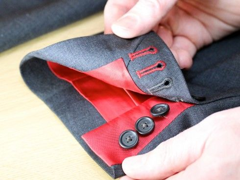 Working cuff with contrast lining and matching button hole stitching
