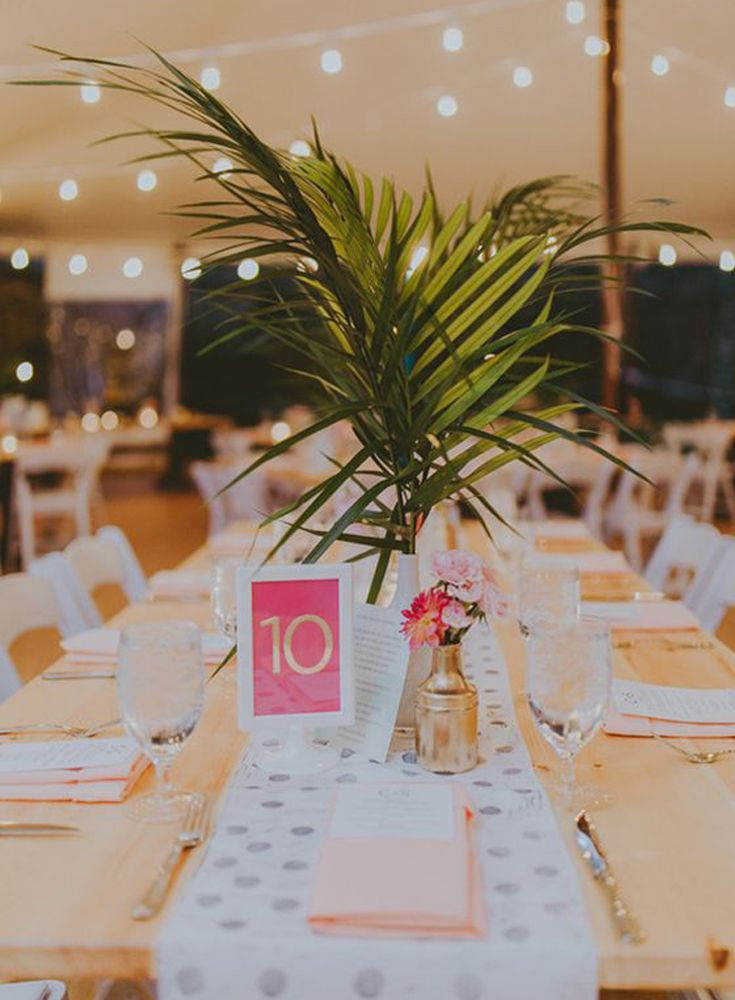 Palms are aplenty in the tropics. Even if you're having a tropical chic wedding in a less-than-tropical location, you can still pick up fake fronds at craft supply stores. Stick them in flower arrangements, line the aisle or use them as place mats. | Pull Out the Palm Fronds | 5 Ways to Decorate a Tropical Chic Wedding | My Wedding Favors