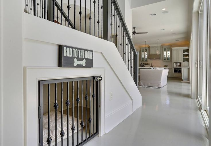 Under stairs dog crate - love how the gate matches the spindles