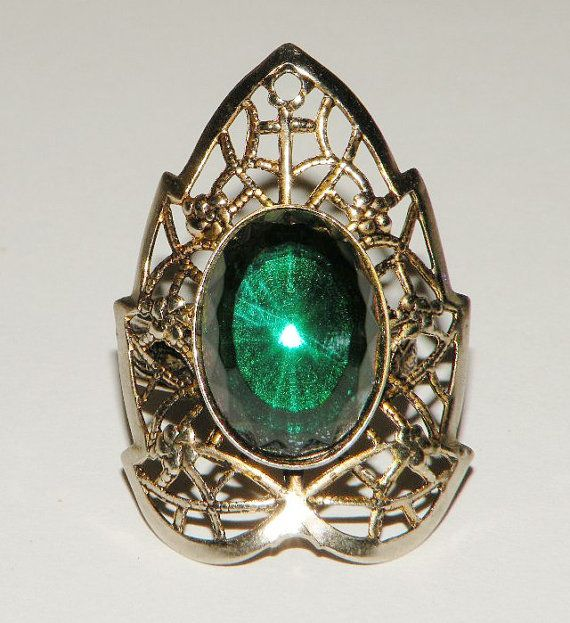 This is a great piece for a female Loki costume, no?    Vintage Green Glass and Guilloche Costume Ring by Eosophobish, $15.00