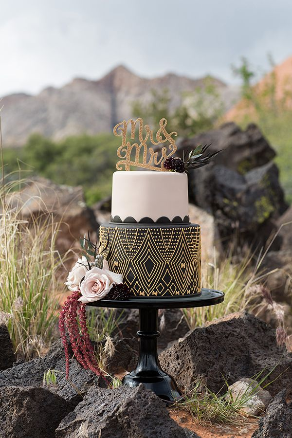 black and gold wedding cakes - photo by Tyler Rye Photography http://ruffledblog.com/elegant-african-inspired-mountain-wedding