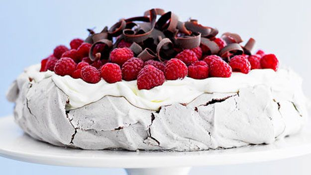 A mouth-watering Chocolate pavlova with raspberries recipe.