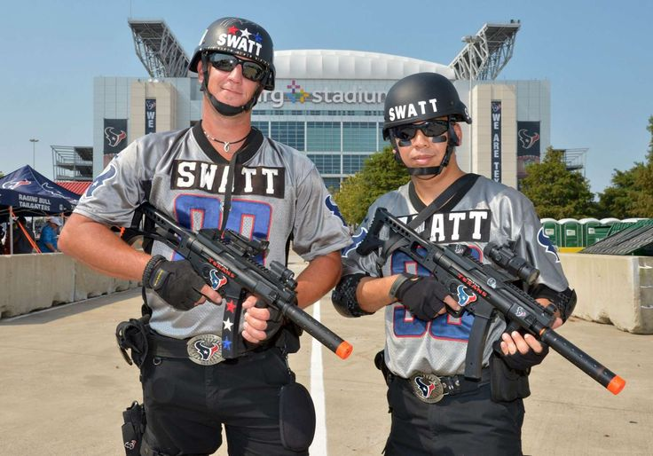 Houston Texans -  Houston Texans fans of defensive end J.J. Watt (not pictured), Gary Wood (left) and Jeff Khong of SWAT, tailgate before the preseason NFL game against the San Francisco 49ers at NRG Stadium on Aug. 15 in Houston. - © Kirby Lee/USA TODAY Sports