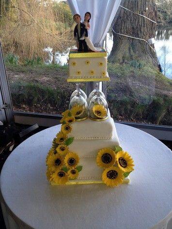 Awesome wedding cake. Sunflower. Bride and groom . Talented cake technician Geraldine Masson